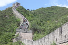 Visitors walks on the Great Wall of China on Royalty Free Stock Image