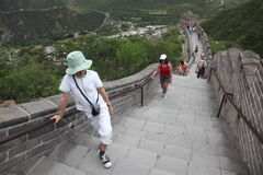 Visitors walks on the Great Wall of China on Stock Photo