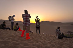 Visitors watch sunset Stock Images