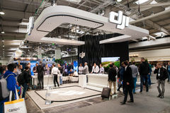 Visitors watching drones by DJI company on exhibition Cebit 2017 in Hannover Messe, Germany. Hannover, Germany - March, 2017: Visitors watching drones by DJI stock images