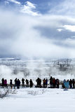 Visitors watching the eruption of a geyser in Iceland Royalty Free Stock Photo