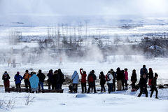 Visitors watching the eruption of a geyser in Iceland Royalty Free Stock Photography