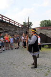 Visitors watching reenactment of soldier loading musket for demonstration,Fort William Henry,New York,2016 Royalty Free Stock Photography