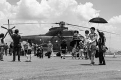 Visitors were watching one of the helicopter at Bandung Air Show. stock photography