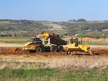 Vislock river, Poland - may 2, 2018:A dump truck is loaded with soil. Land works in the quarry of river gravel. Extraction of natu stock photos