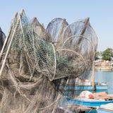 Visnetten, vismanden en vissersboten Stock Foto's