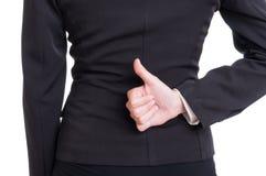 Visning för hand för affärskvinna som behind baksida Arkivfoton