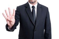 Visning nummer fyra för affärsman med fingrar Arkivfoto