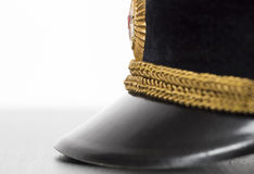 Visor military cap closeup. Visor military cap, lying on the table, close-up Royalty Free Stock Photos