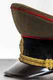 Visor military cap closeup. Visor military cap, lying on the table, close-up Royalty Free Stock Photography
