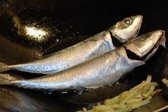 Vissen bij het koken Royalty-vrije Stock Foto's