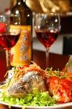 Vissen met rode wijn Stock Afbeelding