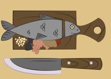 Vissen op een scherpe raad Stock Foto