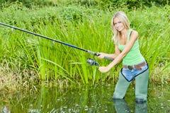 Vissende vrouw stock afbeeldingen