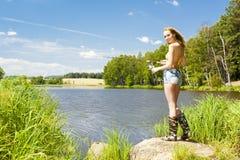 Vissende vrouw Stock Foto