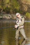 Vissende vrouw Stock Foto's