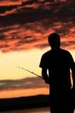 Visser bij zonsondergang Stock Foto