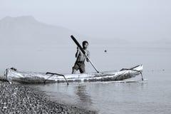 Visser in een boot Stock Afbeeldingen