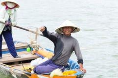 Visser met zijn vangst royalty-vrije stock foto's