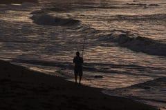 Visser op het strand Stock Afbeeldingen