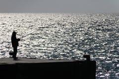 Visserij bij de rand van de oceaan Royalty-vrije Stock Afbeeldingen