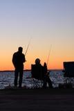 Visserij. De silhouetten van de zonsondergang Royalty-vrije Stock Foto