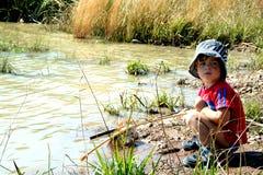 Visserij in een vijver Stock Foto