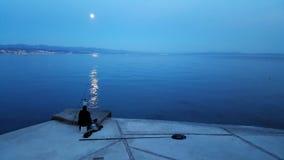 Visserij in het maanlicht Royalty-vrije Stock Afbeeldingen