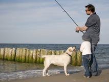 Visserij met hond royalty-vrije stock afbeeldingen