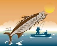 Vissers die een tarpoenvis vangen Stock Foto's
