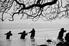 Vissers in het water Royalty-vrije Stock Afbeeldingen