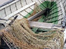 Vissersboot en netto stock fotografie
