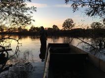 Vissersboten bij zonsondergang royalty-vrije stock foto's