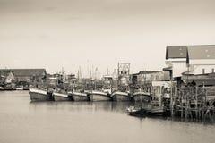 Vissersboten in sepia worden gedokt die Royalty-vrije Stock Fotografie