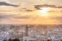 Opinión aérea de Málaga en la puesta del sol Imagenes de archivo