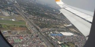 Vista aérea das casas dentro de um avião Fotografia de Stock Royalty Free