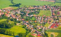 Vista aérea del campo con la aldea Fotografía de archivo libre de regalías