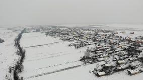 Vista aérea del paisaje del invierno, campo en Ucrania Alise la mosca delantera almacen de metraje de vídeo