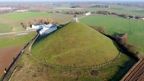 Vista aérea do monte do leão com terra de exploração agrícola ao redor filme