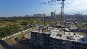 Vista aérea na construção da construção Trabalhadores do canteiro de obras, antena, vista superior Vista aérea do canteiro de obr Imagens de Stock Royalty Free