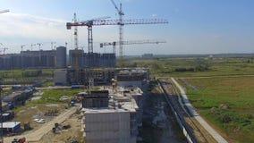 Vista aérea na construção da construção Trabalhadores do canteiro de obras, antena, vista superior Vista aérea do canteiro de obr Imagem de Stock