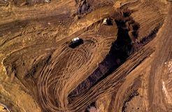Vista aerea dei camion che portano terra Immagine Stock