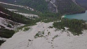 Vista aerea della colata di fango con neve alta nelle montagne alpine stock footage