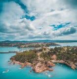 Vista aerea della linea costiera irregolare dell'oceano vicino all'Eden, NSW, Australia Immagine Stock