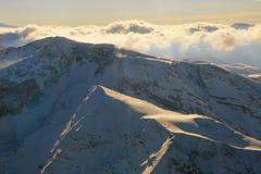 Vista aerea delle alpi dall'aeroplano Immagine Stock