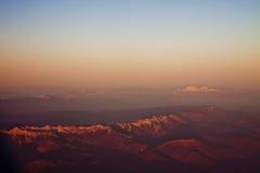 Vista aerea delle alpi italiane al tramonto Fotografie Stock