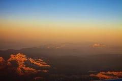Vista aerea delle alpi italiane al tramonto Immagini Stock