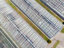 Vista aerea delle costruzioni di vetro della serra Fotografie Stock Libere da Diritti