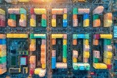 Vista aerea delle costruzioni variopinte in città europea al tramonto fotografia stock libera da diritti