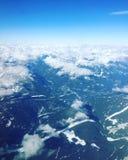 Vista aerea delle montagne innevate Immagine Stock
